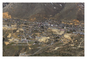 Medium wide aerial view of Downtown Virginia City, Nevada aerial image photograph print view