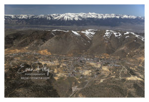 Wide aerial view of Downtown Virginia City, Nevada aerial image photograph print view Washoe and Tahoe is behind